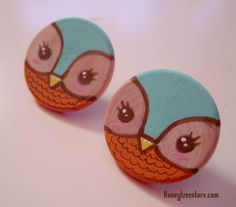 These are hand painted owl earrings on wood.  approx size: 1inch  Artist:Elena Velasquez  Check out our website: honeytreestore.com