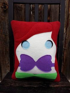 Pillow measures approximately 14 x 12 inches Made entirely from top quality fleece with some felt details.    Extremely soft and snugly.    Generously