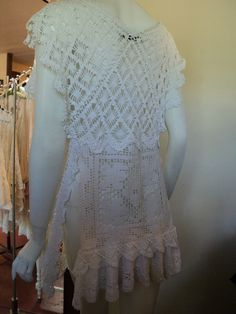 The back on this designer's top is such a cute way to use a crochet doily. Love it.