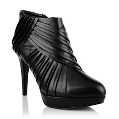 Platform covered boots by CHARLES & KEITH