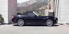 The FIAT® 124 Spider Lusso features a black cloth soft top which features a glass rear window and premium insulation sound barrier that help reduce noise. Model shown in Nero Cinema (jet black).