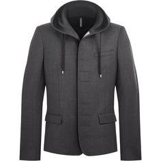 Une veste en flanelle de laine micro-carreaux gris foncé tient sa particularité de la capuche et les sous-pattes de lin aux boutonnières.
