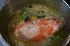Preparation of traditional Greek fish soup with scorpion fish, potatoes, olive oil, celery, carrots, onions, zucchini, ground pepper