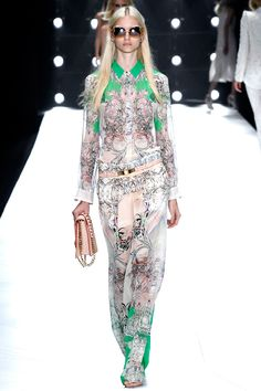 Thank you Cavalli for having the model carry her shoulder strap and not wear it on that beautiful outfit.