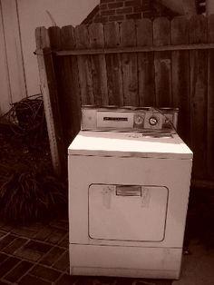Broken down dryer in the backyard