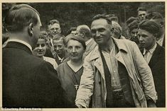'Man of the people': Another image in the collection shows him greeting workers  Read more: http://www.dailymail.co.uk/news/article-2737593/Photos-Adolf-Hitler-young-man-discovered-box-World-War-II-souvenirs.html#ixzz3Brz0Jnoc  Follow us: @MailOnline on Twitter   DailyMail on Facebook