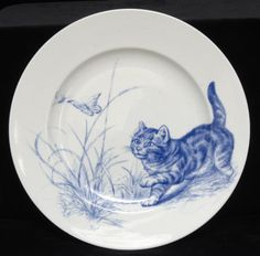 One of twelve circular plates, each decorated with a different image of cats. Kingston Lacy © National Trust / Simon Harris. Kitten and butterfly
