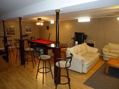 Great Idea on turning those basement support poles into mini-tables for a basement rec room!