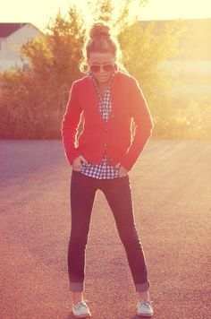Cute fall outfit... colored loafers, cuffed pants, gingham navy shirt, orange cable knit zip up sweater, messy top knot bun, aviators