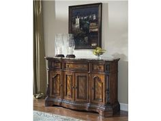 Shop for Millennium Dining Room Server, D705-60, and other Cabinets at Russell's Fine Furniture in Santa Clara, CA, California, 95051, Santa Clara County. With the rich Old World beauty of serpentine flowing curves and elaborately moulded ornate detailing all bathed in a dark cherry stain finish, the Ledelle dining collection flawlessly transforms the decor of any dining area with a sophisticated atmosphere that is sure to enhance any dining experience.