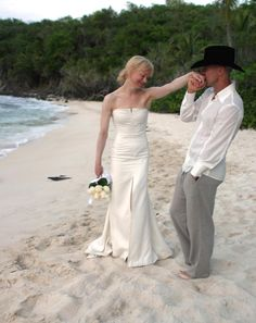 "Pictured on their wedding day, the happy couple, Kenny Chesney and Renee Zellweger, wed in May 2005 in the U.S. Virgin Islands.  Their marriage was annulled by September of the same year. Chesney cited the loss of his individual identity and ""fraud"" as the main downfall of the relationship, in an interview with the Huffington Post."