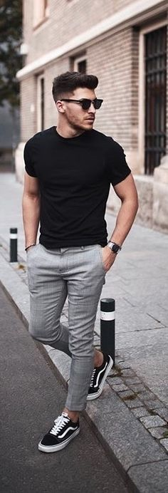 Summer monochrome outfit idea with a black t-shirt sunglasses gray trousers silver watch no show socks black old skool vans sneakers  #summerstyle #summeroutfits #monochrome #menswear #menstyle #tshirt #minimal #streetstyle #streetwear #vans #blackandwhite #sunglasses