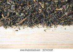 green tea leaves on wooden table. [blur and select focus background]