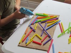 Straws and glue gun. MAK note; Love seeing kids use a glue gun.