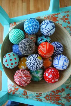 Handmade colorfully patterned ornaments covered in fabric. Each ornament is entirely unique! Created by Uccellinodesigns on Etsy. $5.00 each.
