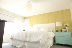 Lovely combination of the golden yellow accent wall, the white sheets and the robin's egg blue dresser.