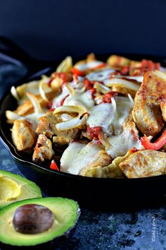 This Chicken Fajita Nacho recipe will become one of your favorite ways to enjoy fajitas! Made of chicken, peppers, onions, cheese, and salsa all piled on top of nachos!