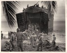 1944- U.S. Coast Guard-manned LST lands troops on South Pacific beach.
