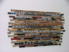 Wall decor made out of a hockey players favorite sticks from their career..cool idea