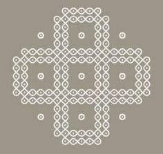 A Kolam pattern that was drawn with curved lines around guiding dots.