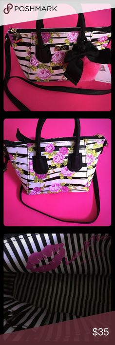 BETSEY JOHNSON PURSE Black and white striped with hot pink roses, Two handles one for carrying and one for cross over also on front has a hot pink Pom Pom and black bow,The purse is 10 1/2 inches wide and 8 inches long, this is such a cute purse.🌺🌺🌺🌺🌺 Betsey Johnson Bags Crossbody Bags