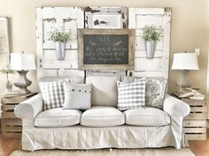 Farmhouse living room! IKEA couches with chippy doors. IG @bless_this_nest