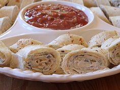 Texas Tortilla Roll-Ups Recipe Appetizers with cream cheese, soften, sour cream, green onions, chopped green chilies, shredded sharp cheddar cheese, black olives, flour tortillas, picante sauce