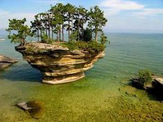 Just off the Michigan shore in Lake Huron is Turnip Rock, a large turnip-shaped rock-island. The unique shape is the result of thousands of years of erosion by storm waves.