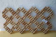 This unique wine cork board is made using recycled wine corks and lattice. The corks have been sliced in half and securely mounted onto the wood. A