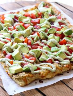 Puff pastry baked with pizza pesto and cheese. Topped with avocado, ripe tomatoes, and red onion and drizzled with Avocado Sauce. Zesty, sweet, and savory.