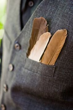 Love this idea - feathers tucked into top pocket instead of a boutonniere