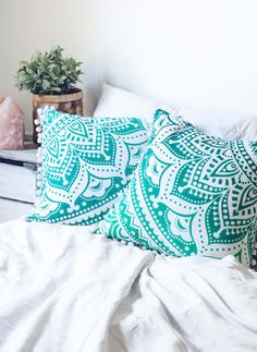 https://marketplace.bohemiandiesel.com/product/turquoise-medallion-cushion-cover/