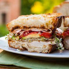 Turkey and Avocado Sandwich. Spice up your regular turkey sandwich by adding alfalfa sprouts avocados and pesto. Truly a delicious and fulfilling lunch meal! Turkey Avocado Sandwich, Pesto Sandwich, Turkey Sandwiches, Soup And Sandwich, Wrap Sandwiches, Sandwich Recipes, Avocado Burger, Gourmet Sandwiches, Goodies