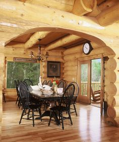 Log home interior: a rug to warm it up even more : )