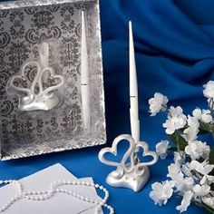 The theme for our wedding can be two joining heart, this pen set can be used along side a registry book with the same hearts.