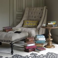 living room beside bookcase - love the round end table, chair and ottoman