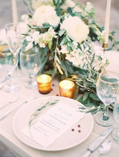 Reception | Centerpieces | love how the greenery cascades down, great balance of green textures and white flowers. Love the white flower types
