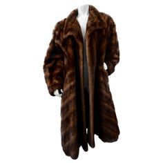 Stay cozy in style all winter long! Circa this Christian Dior billowy coat is made of gorgeous two-tone brown mink fur. Features a notched collar and fully lined interior. The perfect coat to get you through winter! Fur Puffer Coat, Fur Coat, Vintage Fur, Mink Fur, Christian Dior, Personal Style, Fashion Outfits, Clothes, Black