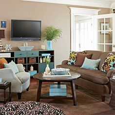 Love the brown and blue...... Same thing I got going in my bedroom. Looks good in a living room, though.