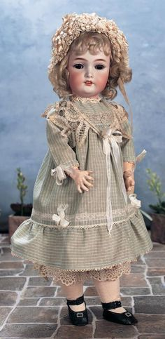 """*GERMAN BISQUE CHILD ~ by: SIMON & HALBIG IN PRETTY ANTIQUE COSTUME, 20"""" T. Bisque socket head, brown glass sleep eyes....MARKS: S&H CT 8 1/2. COMMENTS: Simon & Halbig, c.1900..... Theriault's Antique Doll Auctions"""