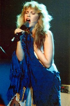 """Stevie ~ ☆♥❤♥☆ ~ singing and holding her blue shawl during her 'Bella Donna' tour; """"My mom, if she were here today, would say 'Stevie, that was a very good choice of fabric because you know silk chiffon is what they make boat sails from, which means it will last forever. And you'll never have to get another one.' And she was totally right. There's not one thread that's gone from this, it's perfect. So that's my little endearing story of my mom. Thank you, Barbara!"""" San Diego, March 3rd, 2017"""