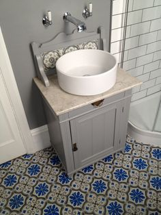 Adapted Victorian marble-topped washstand (a junk shop find!) Arc taps from C.P. Hart, bespoke encaustic floor tiles from Mosaic del Sur http://m.cement-tiles.com/. Metro tiles. Retro vibe!