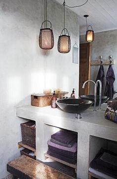 strakke betonlook badkamer te maken met celbetonblokken en speciale verf, ben alleen de naam kwijt