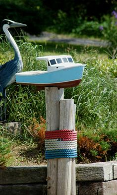 Picture of model ship used in beach-theme yard.