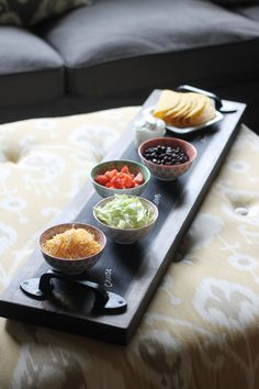 DIY Chalkboard Serving Tray is super easy and makes the cutest serving tray for the holidays! I am totally making this to use for my appetizers and desserts at my next cocktail party!