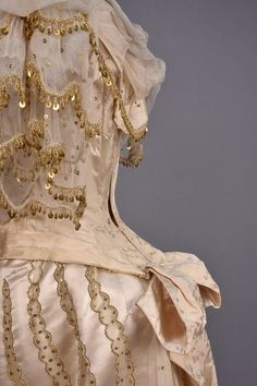 LOT 553 SILK EVENING DRESS with GOLD BEADS, 1880s - whitakerauction