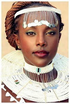 Maasai bride in hand-beaded adornments.