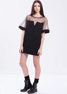MINI DRESS WITH TULLE by PULSE Cocoon black mini dress made out from bled-felt and tulle with geometric cut. Slips on. Material: Felt and tulle. 60% Polyester 30% Viscose 10% Elastane Colour: Black Size: EU 34 - US 2 to EU 44 - US 12 Care: Dry clean.