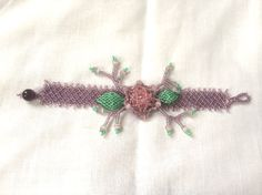 Mauve Flower Bracelet with a Pink Swarovski Crystal, Green Leaves, and Mauve Cats Eye