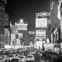 Brightly Lit Signs Shining over Traffic Going Down Broadway Towards Times Square
